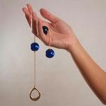 Anaalballen aan gouden ketting / Chapelet Femme Pénétrant