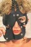 Oogmasker waarvan de ogen en mond afneembaar zijn.
